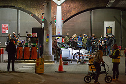 © Licensed to London News Pictures. 30/09/2021. London, UK. A film crew is seen working at a petrol station in Vauxhall, central London filming Channel 4's 'Suspect' with actor James Nesbitt during the seventh day of the fuel crisis. It is being reported that the Texaco petrol station which was closed for the filming was fully stocked. Photo credit: Marcin Nowak/LNP