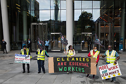 London, UK. 5th August, 2021. Night-shift cleaners belonging to the Cleaners and Allied Independent Workers Union (CAIWU) protest outside the UK headquarters of Facebook. The cleaners are outsourced via the Churchill Group to clean the Facebook offices and CAIWU claims that five additional floors have been added to their workload, that cleaners who have left have not been replaced and that sickness and holiday cover has not been provided.