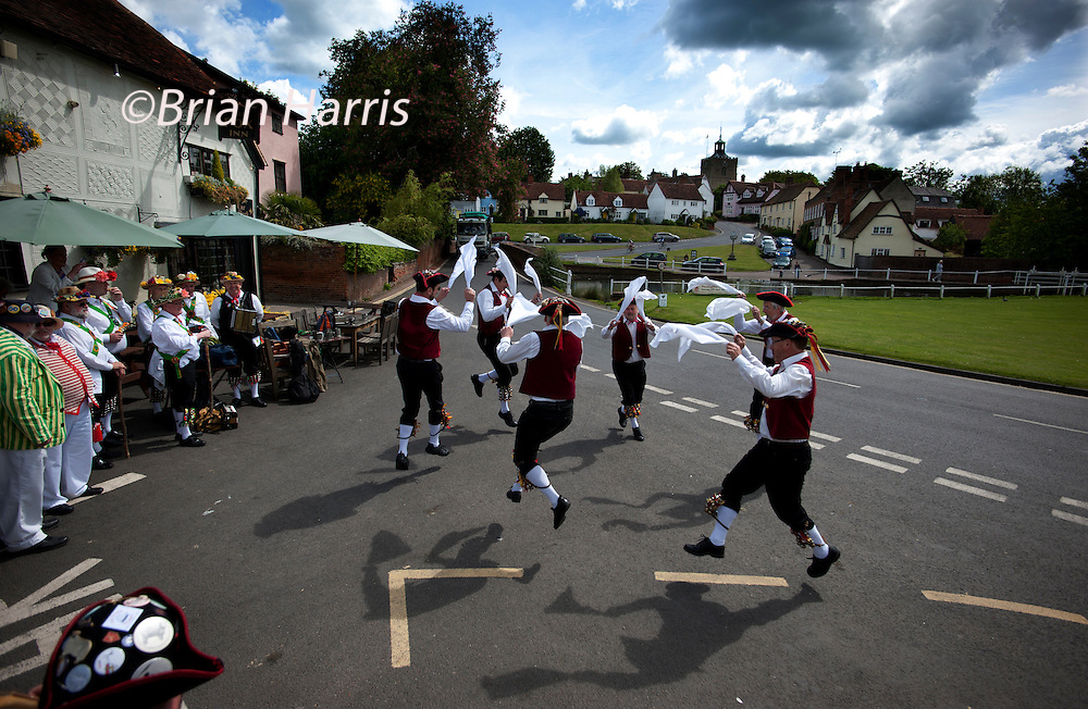 The Thaxted Morris Weekend, Thaxted and surrounding villages, Thaxted, Essex, England. 30 May 2015<br /> Seen here: Victory side from Portsmouth at the Fox Pub in Finchingfield, north Essex.<br /> 21 teams or 'sides' of Morris Men including teams from Holland , Denmak and Australia danced through the villages such as Finchingfield in rural north Essex during the start of the 345th meeting of the member clubs of the Morris Ring and the 82nd meeting hosted by the Thaxted Morris Men.