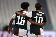 Juventus's Argentinian striker Paulo Dybala is congratulated by Colombian midfielder Juan Cuadrado after scoring to give the side a 1-0 lead during the Serie A match at Allianz Stadium, Turin. Picture date: 26th June 2020. Picture credit should read: Jonathan Moscrop/Sportimage