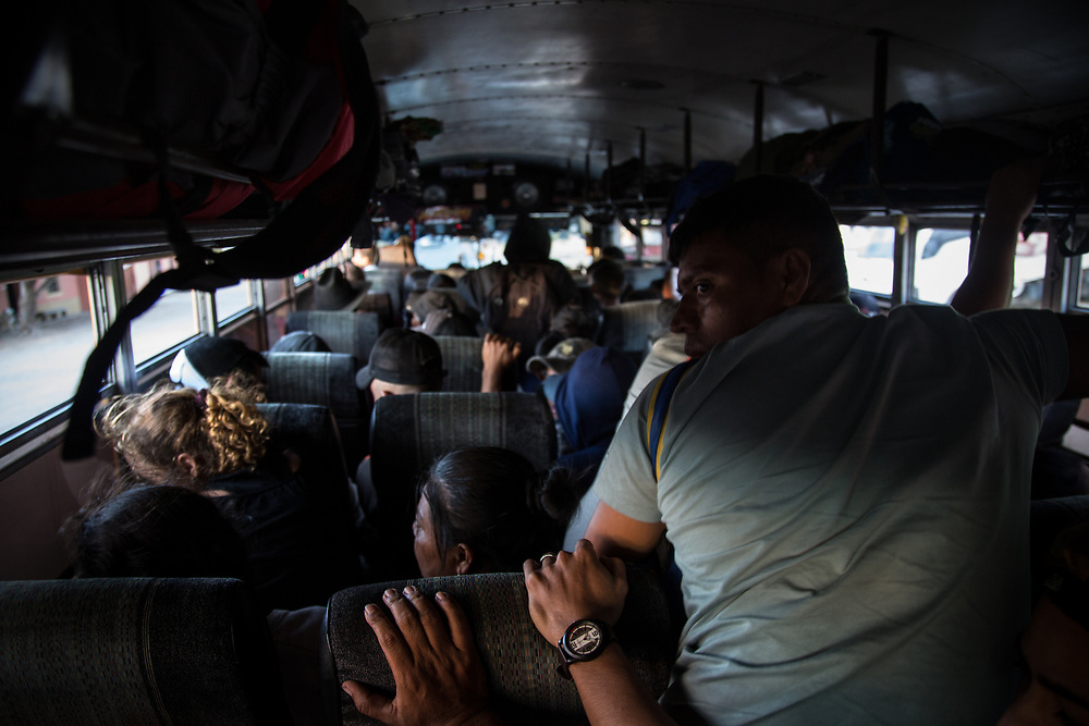 Honduran migrants on a bus to the Guatemalan border begin to crouch down to avoid detection by the police. This attempt was unsuccessful and everyone was taken off the bus.