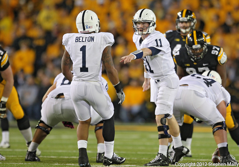 October 20 2012: Penn State Nittany Lions quarterback Matthew McGloin (11) points to running back Bill Belton (1) during the first half of the NCAA football game between the Penn State Nittany Lions and the Iowa Hawkeyes at Kinnick Stadium in Iowa City, Iowa on Saturday October 20, 2012. Penn State defeated Iowa 38-14.