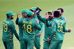Pakistan captain Sarfraz Ahmed (third from right) celebrates with his team