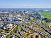 Nederland, Noord-Holland, Amsterdam; 17-04-2021; Knooppunt Amstel, Ring A10 en A2 gezien naar Utrechts. Bedrijvenpark Zuidpark. <br /> Amstel junction, Ring A10 and A2 (towards Utrecht).<br /> Zuidpark Business Park.<br /> <br /> luchtfoto (toeslag op standard tarieven);<br /> aerial photo (additional fee required)<br /> copyright © 2021 foto/photo Siebe Swart