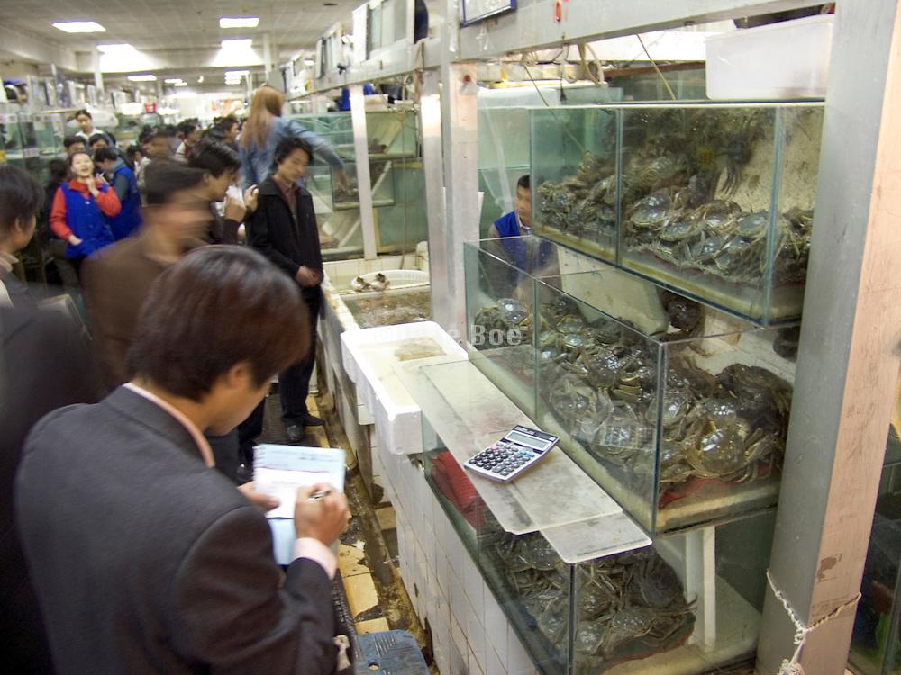 overview of an indoor fish market Beijing China