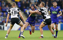 Warrington Wolves' Chris Hill is tackled by Hull FC's Chris Green (left) and Joe Westerman (right) during the Betfred Super League match at the Halliwell Jones Stadium, Warrington.