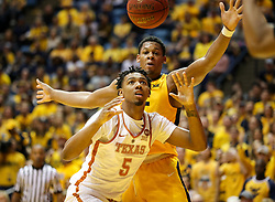 Jan 20, 2018; Morgantown, WV, USA; Texas Longhorns forward Royce Hamm Jr. (5) and West Virginia Mountaineers forward Sagaba Konate (50) go for a loose ball during the second half at WVU Coliseum. Mandatory Credit: Ben Queen-USA TODAY Sports