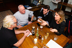Paul Greendale, left, a remain-voting musician and producer discusses Brexit with Philip Davenport, second left, a construction worker and ardent brexiteer discuss Brexit with Bild Reporter Philip Fabian and Samantha Dark, a Remainer, 45, at the Whippet Inn in North West London . London January 13 2019.