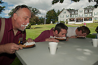 Bob McKinney, Scott Pelchat and Brandon Rutherford take on the pie eating contest during Staff Appreciation Week at the Taylor Home Community Friday afternoon.  (Karen Bobotas/for the Laconia Daily Sun)