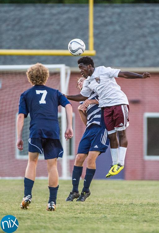 Jay M. Robinson's David Kayembe (18) heads the ball against Hickory Ridge Tuesday night at Jay M. Robinson High School.
