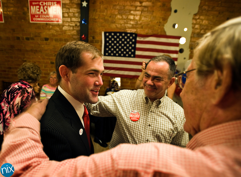 Cabarrus County Commission candidate Chris Measmer is congratulated by his father Rex Measmer, center, and supporter Bill Babb as results come in showing Chirs Measmer leading all Republican candidates in the primary election Tuesday night. (Photo by James Nix)