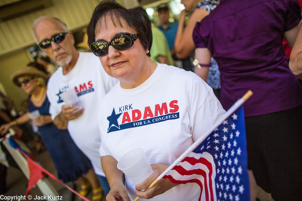 27 AUGUST 2012 - GILBERT, AZ:  Supporters of Kirk Adams wait to hear Sarah Palin campaign on Adams' behalf Monday. Sarah Palin campaigned for Arizona Republicans aligned with the Tea Party movement at a barbecue in Gilbert, AZ, a suburb of Phoenix. She campaigned for Kirk Adams, who is running for Congress and Jeff Flake, who is running for US Senate. Palin spoke and served barbecued chicken in 108 degree heat.      PHOTO BY JACK KURTZ