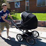 Aarhus, Denmark, June the 3rd, 2010..Thomas pushing the baby carriage.