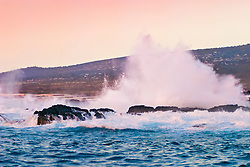 large waves pounding on lava rocks, rugggd shoreline of Kaiwi Point at sunset, Kona Coast, Big Island, Hawaii, USA, Pacific Ocean
