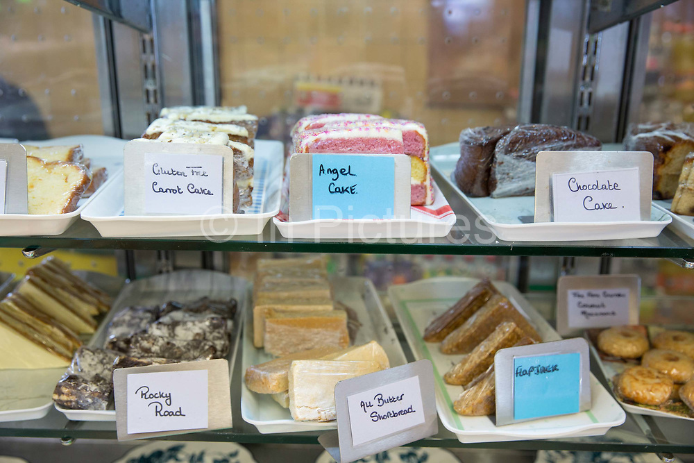 A self serve counter selling a selection of fresh cake wrapped in cling film at the Farm Cafe in rural Holbeach on the 23rd June 2017 in Norfolk, United Kingdom. Established during the 1950's after the owners parents set up a tea stop on the east bound A17, the cafe has grown over the years and attracts coach loads of tourist and travellers often en route to the north Norfolk coast.