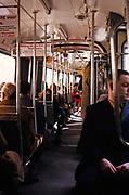 Passengers sitting inside a streetcar tram in Amsterdam, Netherlands 1973