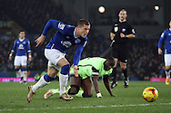 Ross Barkley of Everton makes a break as Yaya Toure of Manchester City is left on his knees.  Capital one cup semi final 1st leg match, Everton v Manchester city at Goodison Park in Liverpool on Wednesday 6th January 2016.<br /> pic by Chris Stading, Andrew Orchard sports photography.