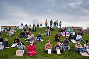 """17 OCTOBER 2020 - DES MOINES, IOWA: People wait for the """"We Dissent Women's March"""" to start in a park in downtown Des Moines. About 300 women participated in the We Dissent Women's March in Des Moines. The march was one of several held across the US to protest the confirmation of Amy Coney Barrett to the Supreme Court seat once held by Ruth Bader Ginsburg. The women marched through downtown and passed by the closed offices of US Senators Chuck Grassley and Joni Ernst.         PHOTO BY JACK KURTZ"""