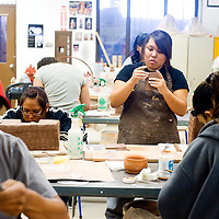 041113     Brian Leddy<br /> Marinell White, right, works on her art during a ceramics class at the University of New Mexico-Gallup Thursday.