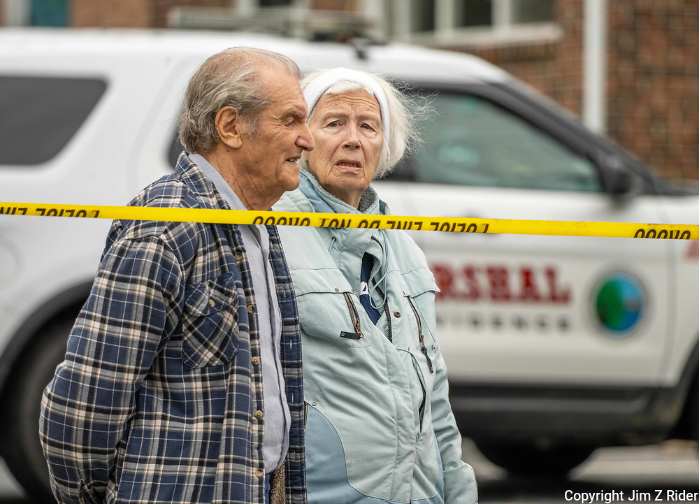 Boris Pevzmer, 94, and Natalya Kirillova, 82, wait as their daughter searches through their home for valuables.  She recovered two computers.  Their home suffered smoke and water damage and all the widows were blown out in the blast.