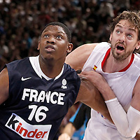 15 July 2012: Kevin Seraphin of Team France vies for the rebound with Pau Gasol of Team Spain during a pre-Olympic exhibition game won 75-70 by Spain over France, at the Palais Omnisports de Paris Bercy, in Paris, France.