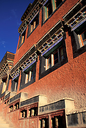 Asia, Northern India, Ladakh, Thikse gompa (monastery) c. 1400s, colorful walls with inset prayer wheels (PR)