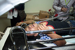 © under license to London News Pictures.  18/02/2011. Protesters are brought into Salmnya Heath Complex in Manama, Bahrain to be treated after being shot at by the police. Photo credit should read Michael Graae/London News Pictures