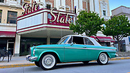 A Studebaker in front of the State Theater in downtown South Bend.
