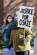 A protester holds a sign in State College, Pennsylvania on March 19, 2021. The 3/20 Coalition organized a protest and march to mark the second anniversary of Osaze Osagie being shot and killed by State College police at his apartment. (Photo by Paul Weaver)