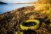 """Abandoned tyre washed up on shores of Slaney river, Wexford This mage can be licensed via Millennium Images. Contact me for more details, or email mail@milim.com For prints, contact me, or click """"add to cart"""" to some standard print options."""