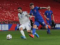 Football - 2022 FIFA World Cup - European Qualifying - Group I - England vs San Marino - Wembley Stadium<br /> <br /> Kieran Trippier of England and Luca Ceccaroli of San Marino<br /> <br /> Credit : COLORSPORT/ANDREW COWIE