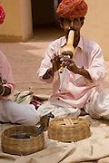 India, Rajasthan, Jaipur, Amber fort built 1592 snake charmers