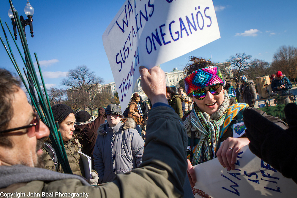 Demonstrators fashion signs to be held during a protest and march from in front of the U.S. Capitol to the EPA, regarding the North Dakota Access Pipeline, as well as the effort to free Leonard Peltier.  Saturday, December 10, 2016. John Boal Photography