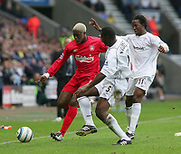 Photo. Andrew Unwin.<br /> Bolton Wanderers v Liverpool, Barclays Premiership, Reebok Stadium, Bolton 29/08/2004.<br /> Bolton's Bruno N'Gotty (C) and Ricardo Gardner (R) look to close down Liverpool's Djibril Cisse (L)<br /> NORWAY ONLY
