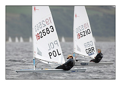 The second day of racing at the World Laser Radial Youth Championships, Largs, Scotland..Tadeusz Kubiak POL 192583 and Cameron Douglas GBR 195210..317 Youth Sailors from 42 different nations compete in the World and European Laser Radial Youth Champiponship from the 17-25 July 2010...The Laser Radial World Championships take place every year. This is the first time they have been held in Scotland and are part of the initiaitve to bring key world class events to Britain in the lead up to the 2012 Olympic Games. ..The Laser is the world's most popular singlehanded sailing dinghy and is sailed and raced worldwide. ..Further media information from .laserworlds@gmail.com.event press officer mobile +44 7866 571932 and +44 1475 675129 .