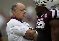 Texas A&M defensive coordinator John Chavis talks with Texas A&M linebacker Keeath Magee II (56) before the start of an NCAA college football game against Auburn on Saturday, Nov. 4, 2017, in College Station, Texas. (AP Photo/Sam Craft)