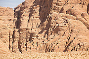Burdah Arch and eroded sandstone cliffs in Wadi Rum, Jordan.