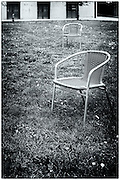 Two chairs on the grass, Venice, Italy.