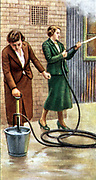 Air Raid Precautions': Set of 50 cards issued by WD & H0 Wills, Britain 1938, in preparation for the anticipated coming of World War II. Women fighting fire with stirrup hand pump.