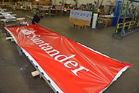 Philadelphia Sign in Pennsauken, NJ manufacturers signs for Santander. Here, a sign is stretched for the face of the sign on September 19/2013. / Russ DeSantis / AP Images for Santander