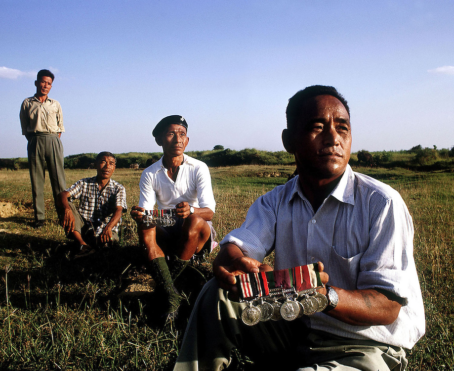 Ex Gurkha soldiers proudly show off their medals near their village of Arthar, Nepal. 1969. Photographed by Terry Fincher