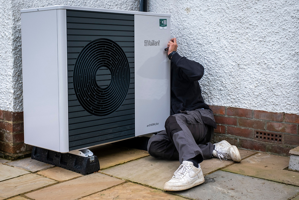 Air source heat pump installers from Solaris Energy installing a Vaillant Arotherm plus 7kw air source heat pump unit into a 1930's built house in Folkestone, United Kingdom on the 20th of September 2021.  With gas prices increasing and the increasing need to reduce fossil fuel air source heat pumps are slowly starting to replace the gas boiler use in properties in the UK. (photo by Andrew Aitchison / In pictures via Getty Images)