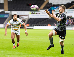 Olly Cracknell of Ospreys collects the ball before scoring<br /> <br /> Photographer Simon King/Replay Images<br /> <br /> European Rugby Challenge Cup Round 5 - Ospreys v Worcester Warriors - Saturday 12th January 2019 - Liberty Stadium - Swansea<br /> <br /> World Copyright © Replay Images . All rights reserved. info@replayimages.co.uk - http://replayimages.co.uk