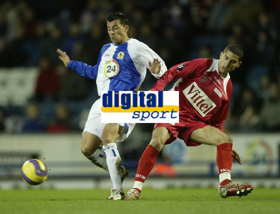 Photo: Aidan Ellis.<br /> Blackburn Rovers v AS Nancy. UEFA Cup. 13/12/2006.<br /> Rovers Sergio Peter (L) loses out to Nancy's Michael Chretien