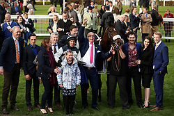 Jockey Ben Moore and his horse Three Star General after winning the Pertemps Champions Willberry Charity Race during the April Meeting at Cheltenham Racecourse