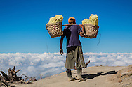 These men carry around 80 kilos of sulfur, twice a day, from the top of the Ijen crater to the valley.  Sometimes, wearing flip flops.  Sometimes rubber boots.