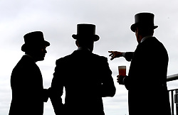 Racegoers talk amongst themselves during day two of Royal Ascot at Ascot Racecourse.