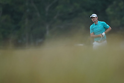 June 16, 2018 - Southampton, NY, USA - Justin Rose hits an approach shot on the 16th hole during the third round of the 2018 U.S. Open at Shinnecock Hills Country Club in Southampton, N.Y., on Saturday, June 16, 2018. (Credit Image: © Brian Ciancio/TNS via ZUMA Wire)