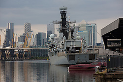 London, UK. 12th September, 2021. HMS Argyll, the longest-serving Type 23 Frigate in the Royal Navy, is pictured moored alongside ExCeL London against a backdrop of Canary Wharf in advance of the DSEI 2021 arms fair. Activists from a range of different groups continue to protest outside the venue for one of the world's largest arms fairs.