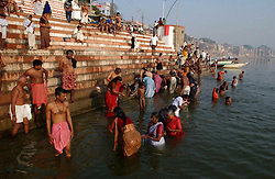 Indians bathe in the holy Ganges river December 9, 2001 in Varanasi, India.  The late George Harrison, a longtime devotee of Hinduism, reportedly left over a million dollars to build a temple in the city of Varanasi  according to Hare Krishna devotees. The news came as hundreds of Harrison fans still waited expectantly by the banks of the River Ganges for his ashes to arrive, amid confusion on how they were to be scattered. (Ami Vitale/Getty Images)